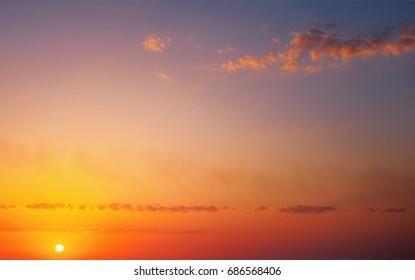 Beautiful fiery orange sunset sky as background