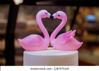 Beautiful figure of flamingos, a symbol of love. Two pink flamigo figures kissing, happy Valentine's day.
