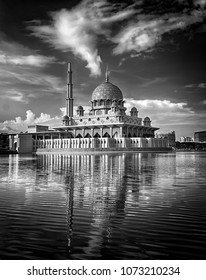 Beautiful fine art black and white of public mosque in Putrajaya, Malaysia with amazing sky and dramatic clouds on the background.