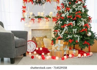 Beautiful fir tree in decorated room for Christmas