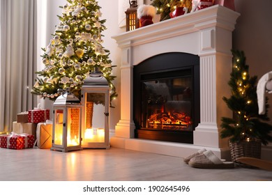 Beautiful fireplace, Christmas tree and other decorations in living room. Interior design