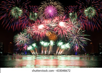 Beautiful firework display for celebration on the river, colorful fireworks for independence day.