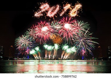 Beautiful firework display for celebration on the river with sparkle of 2018, New year and holidays concept.