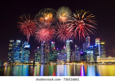beautiful firework over central business district building of Singapore city at night