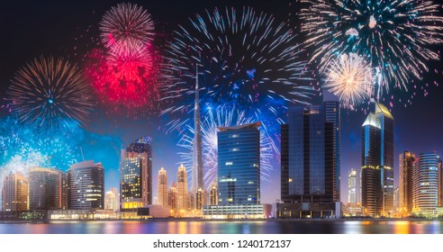 Beautiful fireworks above Dubai Business bay at evening light with reflection on water, UAE