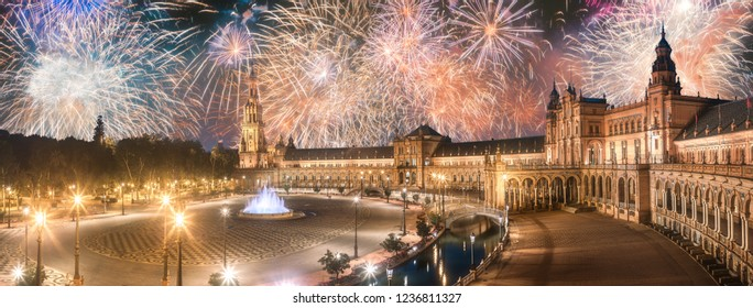 Beautiful fireworks above Spain Square on sunset, landmark in Renaissance Revival style, Seville, Andalusia, Spain.