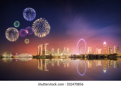 Beautiful fireworks in Marina Bay and view of skyscrapers on Singapore