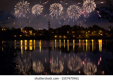 Beautiful fireworks over the city with reflection in the water