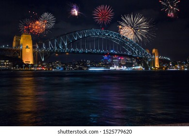 Beautiful fireworks show over the Sydney Opera and Harbour bridge. Celebration concept with massive fireworks display at New Years Eve.