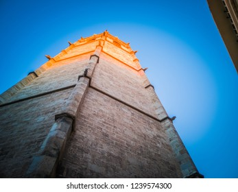 A beautiful first person view photo of the Micalet tower, also known as Miguelete tower, which is popular touristic Valencian gothic style tower bell in the cathedral of Valencia, in Spain, Europe.