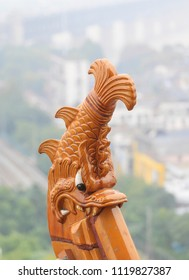 Beautiful fish shaped kiss on the roof of  Tower, details of Chinese traditional architecture