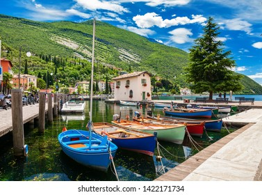 beautiful fishing harbor with colorful boats in Nago-Torbole, Garda lake, Trentino-Alto Adige region, Italy