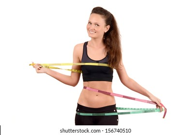Beautiful fit girl measuring her bust, waist and hips with a centimeter. Obsessed woman with three measuring tapes. Isolated on white.