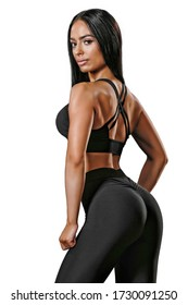 Beautiful fit Girl in sport wear. No bacground. Whie background. Girl with long black hair.