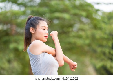 Beautiful fit young woman public park fitness stretching