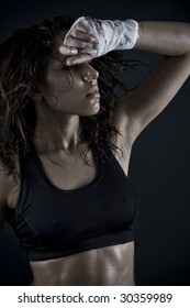 beautiful fitness body. exhausted brunette after workout