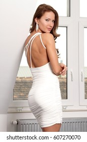 Beautiful fitness fashion girl in tight white dress