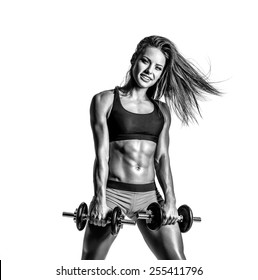 beautiful fitness female posing on a white isolated background in black and white color. high contrast black and white image
