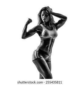 beautiful fitness female posing on white isolated studio background. high contrast black and white image