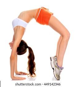 beautiful fitness girl exercising gymnastic bridge, isolated on white background