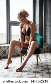 Beautiful fitness girl sexy blonde posing in the room interior