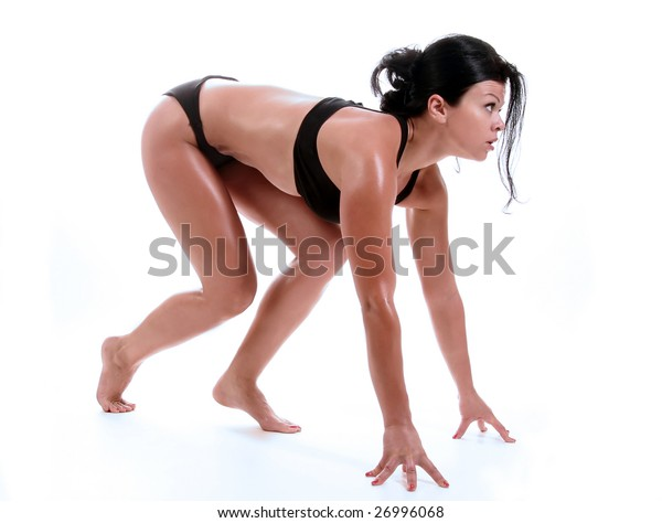 Beautiful fitness girl in start position