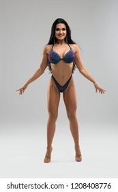 Beautiful fitness model in bikini isolated shot
