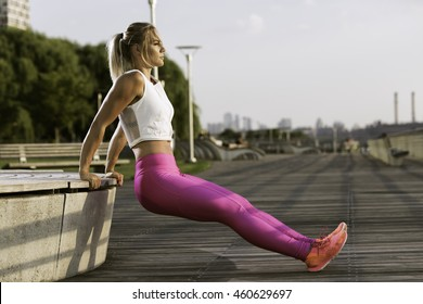 Beautiful fitness model working out by the river