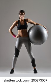 beautiful fitness woman with the exercise ball,  studio shot