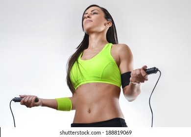 beautiful fitness woman jumping rope