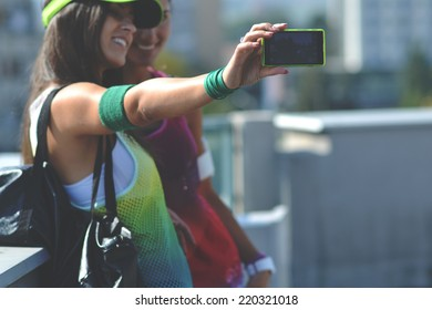 beautiful fitness woman taking picture of themselves, outdoor shot