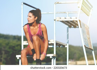 beautiful fitness woman working out, outdoor shot