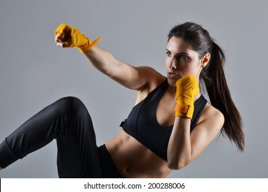 beautiful fitness woman with the yellow boxing bandage