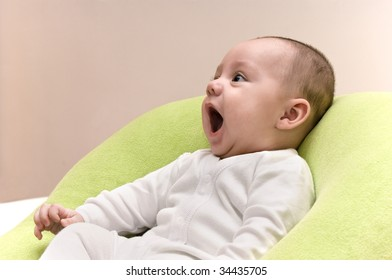 Beautiful five month baby boy laughing