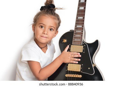 Beautiful five years old girl with  electric guitar isolated on white background (with shadow).