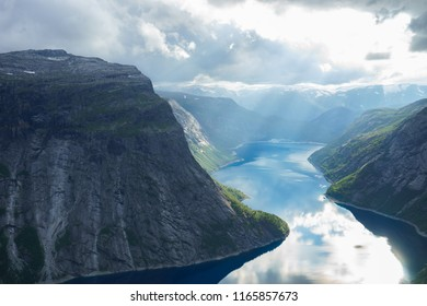 Beautiful fjord in Norway with amazing sun rays. View from the top