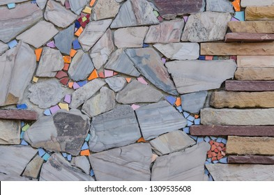 Beautiful flagstone and ceramic scrap decoration on the wall