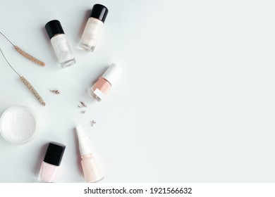 Beautiful flat lay photo with nail polish bottles. Copy space for the text