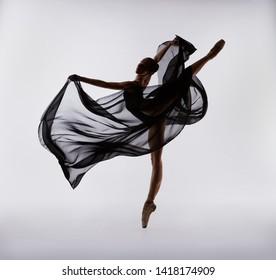 Beautiful flexible ballerina with black flying cloth