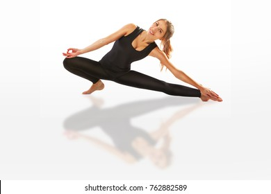 beautiful flexible woman doing yoga poses on white background