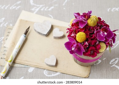 Beautiful floral arrangement with orchid and craspedia flowers