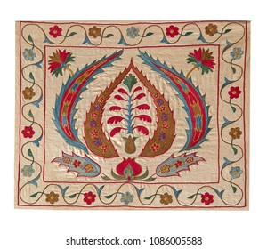Beautiful floral embroidery on beige cotton in oriental style. Isolated