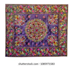 Beautiful floral embroidery on violet velvet in oriental style. Isolated