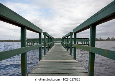 a beautiful Florida day with blue sky by a green wooden wharf at Old Lake Davenport, Florida