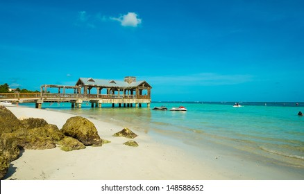 Beautiful Florida Keys beach with covered pier along the shoreline.