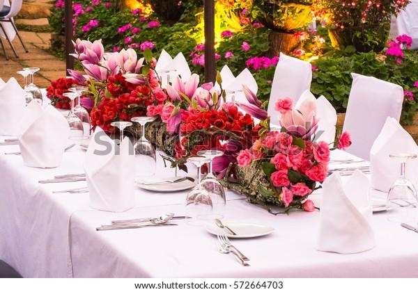Beautiful Flower Arrangement On Dinner Table Stock Photo Edit Now 572664703