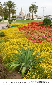 Beautiful flower bed with blooming colorful flowers infront of spiral mosque Doha