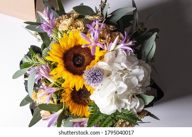 Beautiful flower bouquet with sunflowers on a white background
