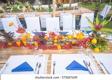 Beautiful flower design with forest style of dinner table at public agriculture station, Thailand.