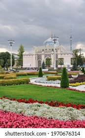 Beautiful flower parterre on the Central alley of VDNKh in background of the restored Kazakhstan Pavilion. MOSCOW, RUSSIA - September 02, 2019